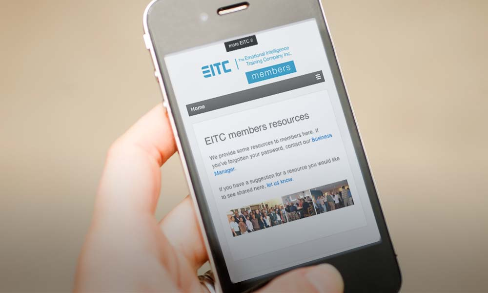 A person looks at the EITC members site on their mobile device